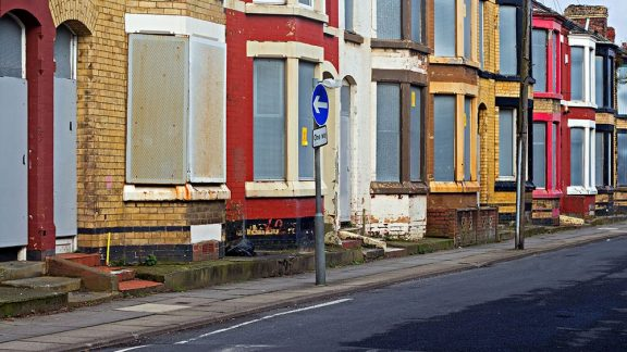 a run down and boarded up residential street