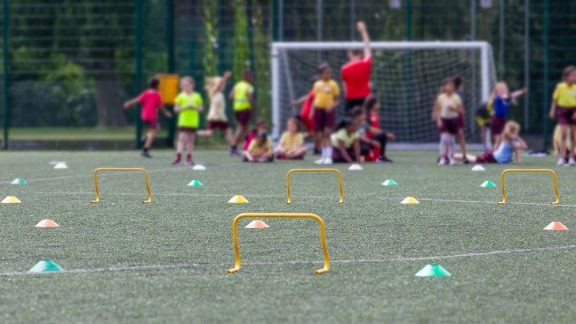 children doing athletic training exercises