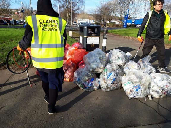 Residents collecting rubbish