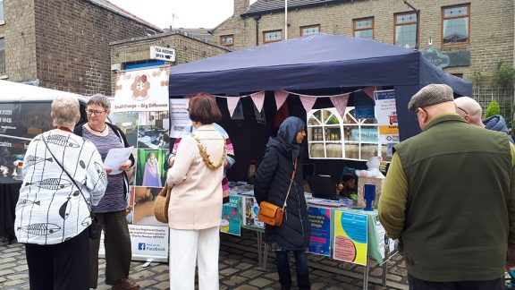 an infobooth at a market in Worsley